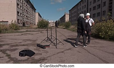 Photographer take pictures of worker
