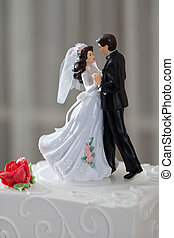 Wedding cake and topper with couple dancing