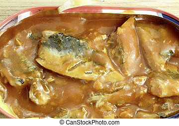 close up of herring in the tin