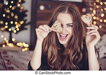 Crazy woman holding cookies in hand