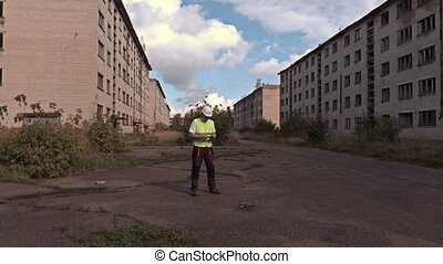 Worker take off drone in summer day