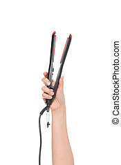 hair straightener - cropped shot of female hand showing hair...