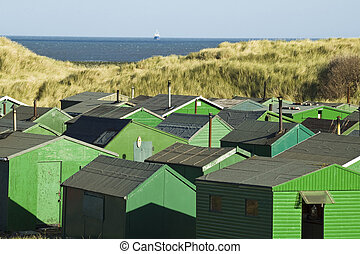 Fishermans huts - abstract scene of fishermans huts at...