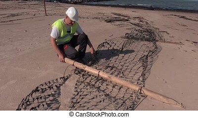 Worker try to fix fence