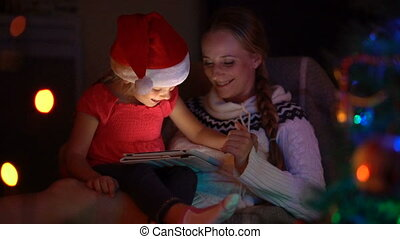Mom and daughter spend the evening before Christmas together...