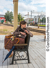 Portrait of a young woman waiting for a train - Portrait of...