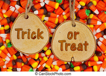 Halloween Trick or Treat Greeting on wood plaque with candy...