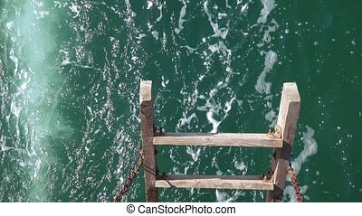 Wooden staircase of the sea - Boiling water behind the...