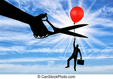 Concept of risks in business - A man climbs up holding onto...