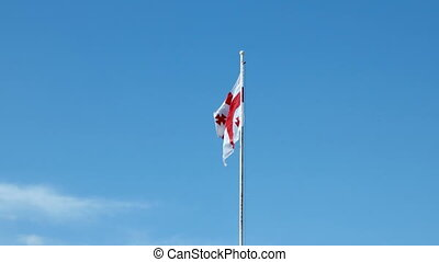Flag of Georgia country waving in the wind against clear...