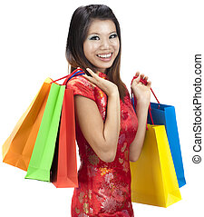 Chinese New Year Shopping - Oriental woman in red...