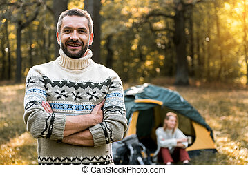 Cheerful married couple relaxing in the woods - Waist up...