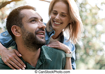 Joyful couple relaxing in forest - Portrait of happy young...