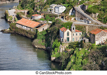 Gaia Riverside in Portugal - Old church and buildings at...