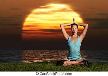 Yogi sunrise. - A sportive beautiful woman training yoga on...