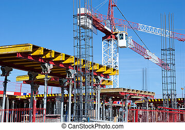Construction Site - A construction site with a crane and...