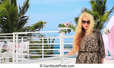 Blonde girl en leopard dress walking in caribbean penthouse....