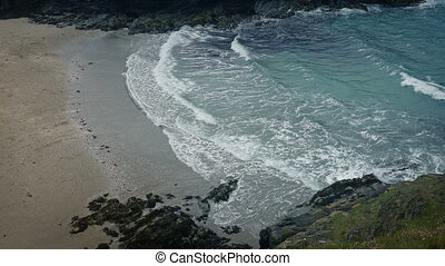 Big Waves Spreading Out Over Beach Landscape - Wide view of...