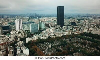 Aerial panoramic shot of Paris cityscape and the Eiffel tower as seen from Montparnasse area, France