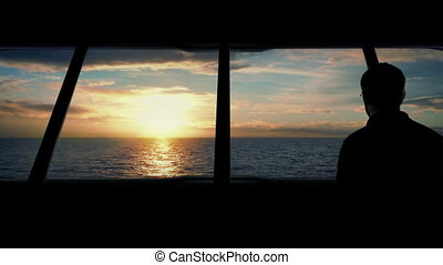 Man Looks Out From Boat At Sunset - Man goes to look at...