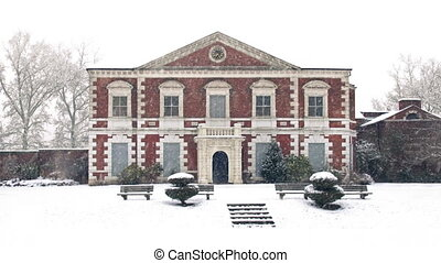 Historic Mansion In Snowfall - Old manor house covered in...