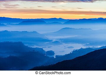 Adams Peak sunrise view - Foggy mountains aerial panoramic...