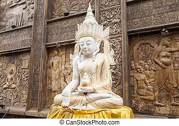 Gangaramaya Temple in Colombo - Buddha statue near...