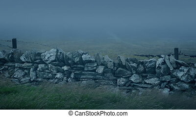 Old Wall In Storm With Mist Rushing Past - Weathered old...