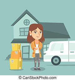 Young caucasian woman moving to a new house. - Young happy...