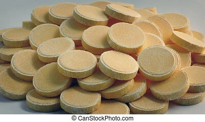 Pile Of Vitamin C Pills Rotating Closeup - Pile of vitamin C...