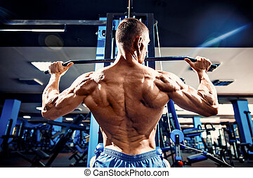 Strong Bodybuilder Doing Heavy Weight Exercise For Back On...