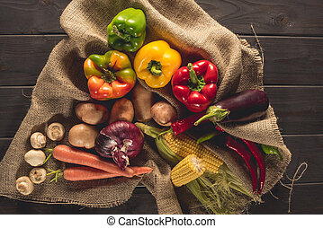 fresh picked vegetables on sacking - top view of fresh...