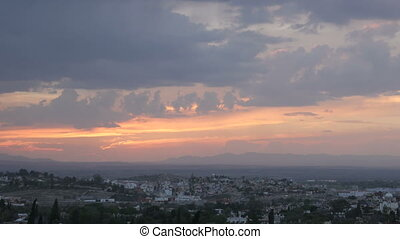 Dramatic sunset timelapse of mountains and traffic in San...