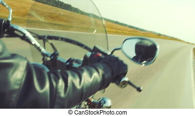 Biker on the autumn road tripping