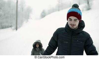 Teenage boy and girl in winter nature. Two teenagers on a...