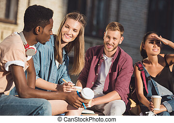 students spending time together - group of happy students...