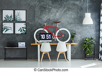 Workspace interior with red bicycle - White chairs in...