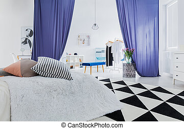 Sophisticated bedroom with geometric carpet - Patterned...