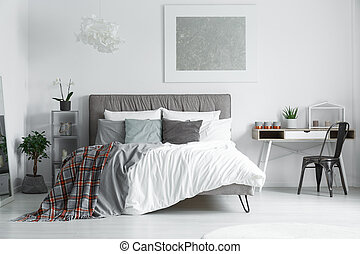 Checked bedsheet lying on bed - Red checked grey bedsheet...
