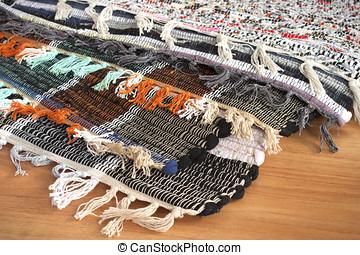Homespun mat of colored ribbons