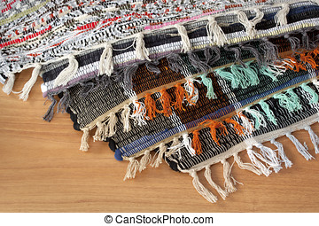 Homespun mat of colored ribbons