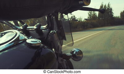 Biker on the country road tripping