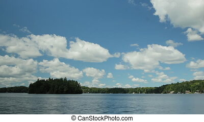 Timelapse clouds over lake. - Summer lake with timelapse...