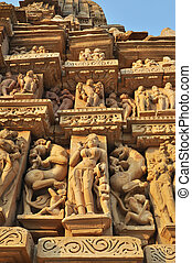 Khajuraho Statues - The temple of Khajuraho, decorated with...