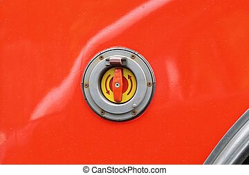 Emergency stop button at red vehicle exterior