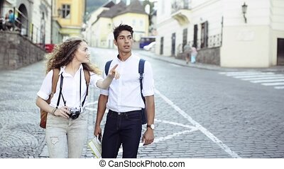 Two young tourists with map and camera in the old town - Two...