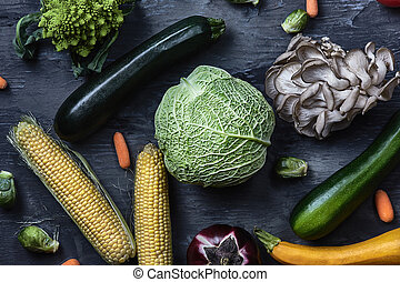 Organic vegetables on wooden table. Top view - Organic...