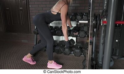 woman doing exercise with dumbbells - Fitness woman doing...