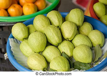 Guavas in marketplace, green color fruit in tropical area