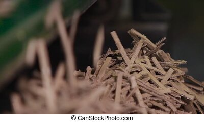 Manufacture of cardboard boxes. - Paper shavings close up,...